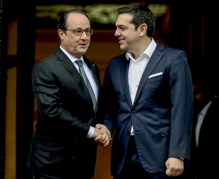 industrialist: Athens, Greece - October 23, 2016: Prime Minister Alexis Tsipras and the President of France Francois Hollande during their meeting at the Maximos Mansion in Athens, Greece.