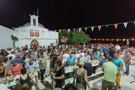 yearly: Ios, Greece - September 7, 2015: People are eating and celebrating at the big yearly festival in the name of Holy Mary in Ios, Greece.