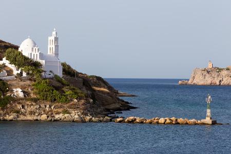 ios: Church view by the sea in Ios island, Greece. Stock Photo