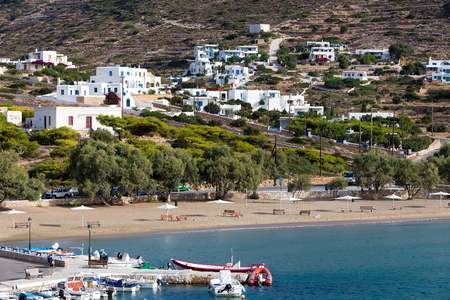 ios: Ios, Greece - September 19, 2015: Classic village with white houses in the island of Ios, Cyclades, Greece. Ios is known as the party island with the lively atmosphere and the endless fun.