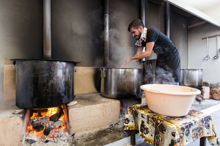 yearly: Ios, Greece - September 7, 2015: Traditional Greek food is being prepared for the big yearly festival in the name of Holy Mary in Ios, Greece.