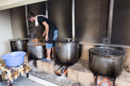 ios: Ios, Greece - September 7, 2015: Traditional Greek food is being prepared for the big yearly festival in the name of Holy Mary in Ios, Greece.