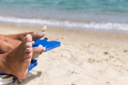 sandy feet: Sandy feet on the beach. Vacation Background