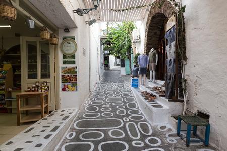 ios: Ios, Greece - September 19, 2015: Pretty Greek Path with stores in Ios island, Cyclades, Greece.