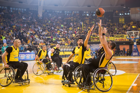 Thessaloniki, Greece - February 28, 2016: unidentified people play a friendly game of wheelchair basketball at Nick Galis stadium 에디토리얼