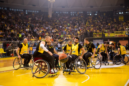 paraplegico: Thessaloniki, Greece - February 28, 2016: unidentified people play a friendly game of wheelchair basketball at Nick Galis stadium Editorial