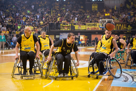 wheelchair users: Thessaloniki, Greece - February 28, 2016: unidentified people play a friendly game of wheelchair basketball at Nick Galis stadium Editorial