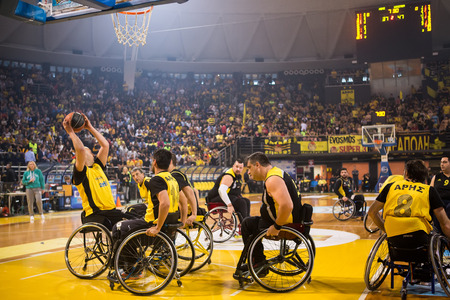 paraplegic: Thessaloniki, Greece - February 28, 2016: unidentified people play a friendly game of wheelchair basketball at Nick Galis stadium Editorial