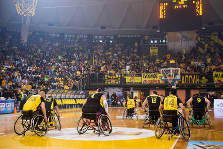 incapacity: Thessaloniki, Greece - February 28, 2016: unidentified people play a friendly game of wheelchair basketball at Nick Galis stadium Editorial