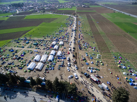 immigrants: Idomeni, Greece - March 1, 2016: Thousands of immigrants are in a wait at the border between Greece and FYROM waiting to cross the borders to FYR of Macedonia. Aerial shot with drone