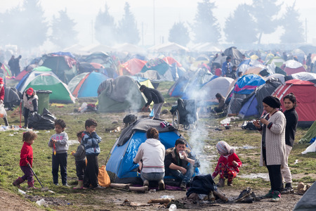 immigrants: Idomeni, Greece - March 8, 2016: Thousands of immigrants are in a wait at the border between Greece and FYROM waiting to cross the borders to FYR of Macedonia. Editorial