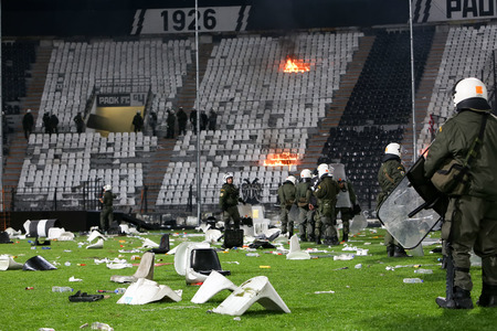 riots: Thessaloniki, Greece - March 02, 2016: PAOK fans clash with riot police during the semifinal Greek Cup game between PAOK and Olympiacos played at Toumba stadium Editorial