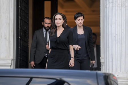 un: Athens, Greece - March 16, 2016: Hollywood star and UN refugee agency envoy Angelina Jolie leaves the Greek Prime ministers office in Athens following a meeting with Greek Prime minister