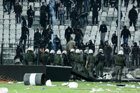 clashes: Thessaloniki, Greece - March 02, 2016: PAOK fans clash with riot police during the semifinal Greek Cup game between PAOK and Olympiacos played at Toumba stadium Editorial