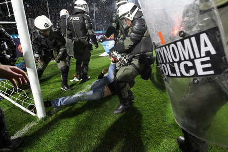 clashes: Thessaloniki, Greece - March 02, 2016: PAOK fans getting arrested after clashing with riot police during the semifinal Greek Cup game between PAOK and Olympiacos played at Toumba stadium