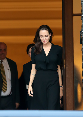 hollywood star: Athens, Greece - March 16, 2016: Hollywood star and UN refugee agency envoy Angelina Jolie leaves the Greek Prime ministers office in Athens following a meeting with Greek Prime minister