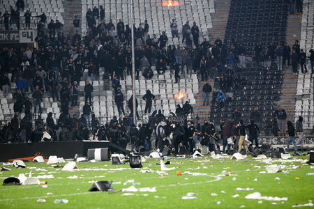 clash: Thessaloniki, Greece - March 02, 2016: PAOK fans clash with riot police during the semifinal Greek Cup game between PAOK and Olympiacos played at Toumba stadium Editorial