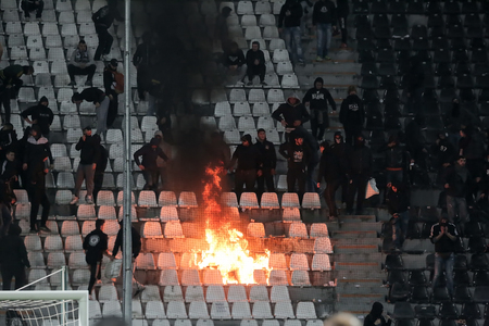 fanatics: Thessaloniki, Greece - March 02, 2016: PAOK fans clash with riot police during the semifinal Greek Cup game between PAOK and Olympiacos played at Toumba stadium Editorial