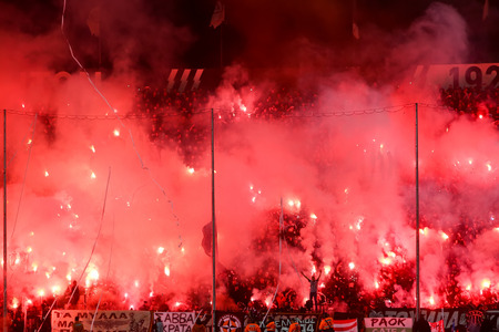 delirious: Thessaloniki, Greece - March 02, 2016: View of the Toumba Stadium full of fans of PAOK who light flares during the semifinal Greek Cup game between PAOK and Olympiacos played at Toumba stadium