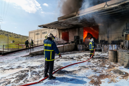 Aspopirgos, Greece - March 28, 2016: Firefighters struggle to extinguish the fire that broke out at a paint factory
