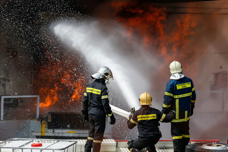 pyromaniac: Aspopirgos, Greece - March 28, 2016: Firefighters struggle to extinguish the fire that broke out at a paint factory