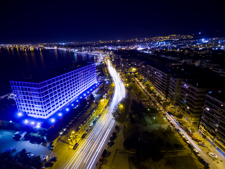 action blur: Aerial view of city Thessaloniki at night, Greece.. Image taken with action drone camera causing distortion and blur.