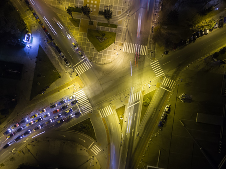 action blur: Aerial view of cross road in Thessaloniki at night, Greece. Image taken with action drone camera causing distortion and blur.