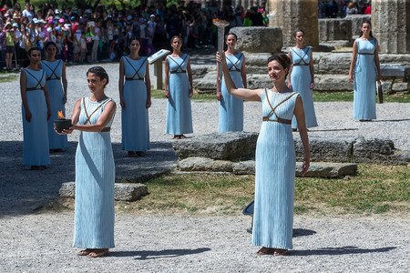 """the architecture is ancient: Olympia, Greece - April 20, 2016: Last rehersal of the The Lighting Ceremony of the Flame for the Olympic Games """"Rio 2016"""" and the Torch Relay, Naos Iras, Archea Olympia."""