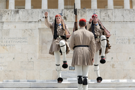 tomb of the unknown soldier: Athens, Greece - September 8, 2015: The Changing of the Guard ceremony takes place in front of the Greek Parliament Building