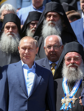 abbot: Mount Athos, Greece - May 28, 2016:The President of the Russian Federation Vladimir Putin (L), the highest abbot of Mount Athos Pavlos of Megistis Lavras (R) during his visit to Mount Athos.