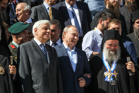 abbot: Mount Athos, Greece - May 28, 2016: Russian President Vladimir Putin, (C), President of Greece Prokopis Pavlopoulos, (L), the highest abbot of Mount Athos Pavlos (R) during his visit to Mount Athos.