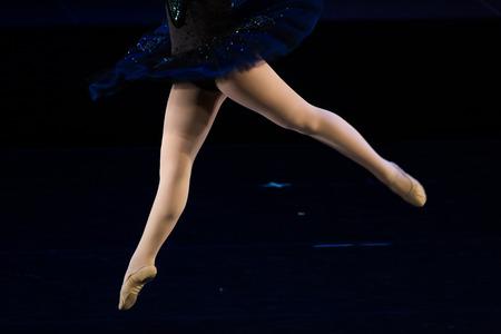 balletic: Dancers during ballet performances.Legs only. Soft focus.