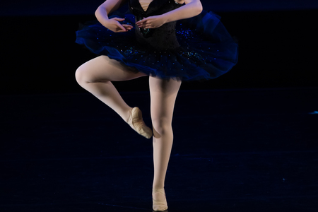 pirouette: Dancers during ballet performances.Legs only. Soft focus.