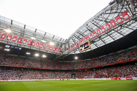 Amsterdam, Netherlands- July 26, 2016: Interior view of the full Amsterdam Arena Stadium during the UEFA Champions League third qualifying round between Ajax vs PAOK 新聞圖片