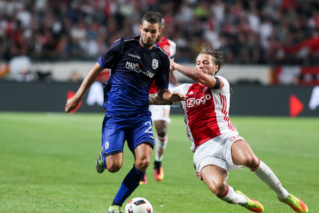 Amsterdam, Netherlands - July 26, 2016: Evgen Shakhov (L) and Mitchell Dijks (R) in action during the UEFA Champions League third qualifying round between Ajax vs PAOK
