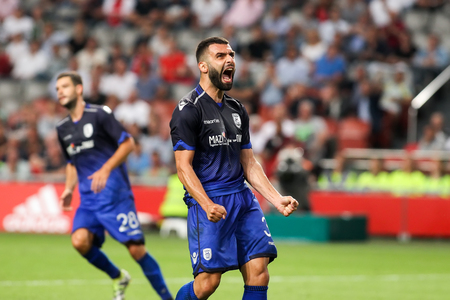 ajax: Amsterdam, Netherlands - July 26, 2016: Giorgos Tzavellas in action during the UEFA Champions League third qualifying round between Ajax vs PAOK