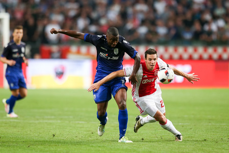 ajax: Amsterdam, Netherlands - July 26, 2016: Djalma Campos (L) and Nick Viergever(R) in action during the UEFA Champions League third qualifying round between Ajax vs PAOK Editorial