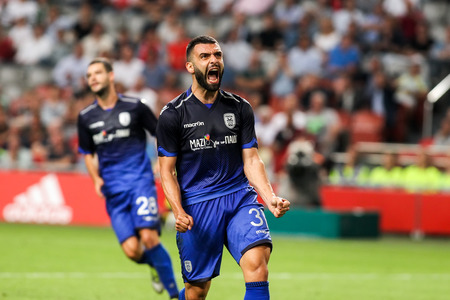 uefa: Amsterdam, Netherlands - July 26, 2016: Giorgos Tzavellas in action during the UEFA Champions League third qualifying round between Ajax vs PAOK