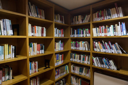 studious: Thessaloniki, Greece - May 12, 2016: Books on the shelves of the Library of University of Thessaloniki. Every day hundreds of students study there Editorial