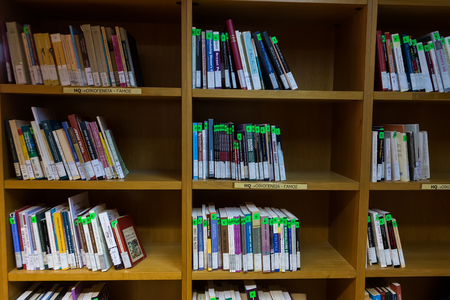 writ: Thessaloniki, Greece - May 12, 2016: Books on the shelves of the Library of University of Thessaloniki. Every day hundreds of students study there Editorial