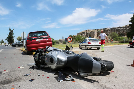 headlight: Argolida, Greece - May 15, 2016: traffic accident between a car and a motorcycle large displacement on country roads
