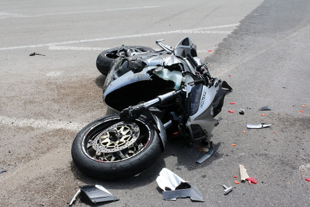 Argolida, Greece - May 15, 2016: traffic accident between a car and a motorcycle large displacement on country roads 版權商用圖片 - 61172784