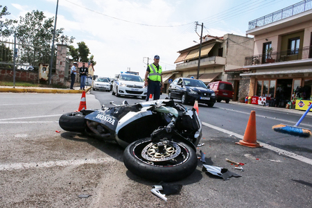 Argolida, Greece - May 15, 2016: traffic accident between a car and a motorcycle large displacement on country roads