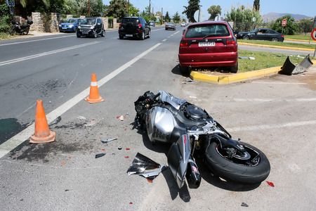 country roads: Argolida, Greece - May 15, 2016: traffic accident between a car and a motorcycle large displacement on country roads