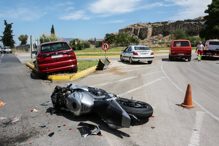 displacement: Argolida, Greece - May 15, 2016: traffic accident between a car and a motorcycle large displacement on country roads