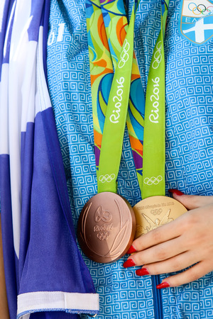 best travel destinations: Thessaloniki, Greece - August 11, 2016: Greek shooting star Anna Korakaki has arrived in Thessaloniki, Greece, with the two medals (gold and bronze) she won in the Rio Olympics