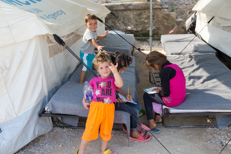 Lagadikia, Greece - August 25, 2016: Children play in the refugee camp of Lagadikia, some 40km North of Thessaloniki, during the visit of UN high commissioner for refugees Filippo Grandi