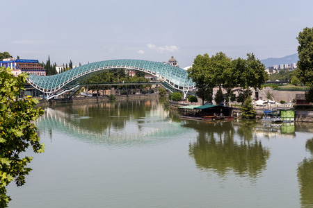 pedestrian bridge: Tbilisi, Georgia - August 18, 2016: Bridge of Peace in Tbilisi, Geaorgia, bow-shaped pedestrian bridge over the Kura River in Tbilisi, capital of Georgia. One of the most important sites of Tbilisi Editorial