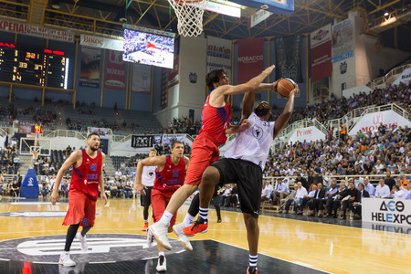 rebound: Thessaloniki, Greece - September 8, 2016: Milos Teodosic (L) of CSKA with Clanton Keith (R) of PAOK in action during the friendly match PAOK vs CSKA Moscow Editorial
