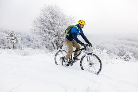 thessaloniki: Thessaloniki, Greece - November 30, 2016: Unknown biker in winter in a snowy landscape in northern Greece